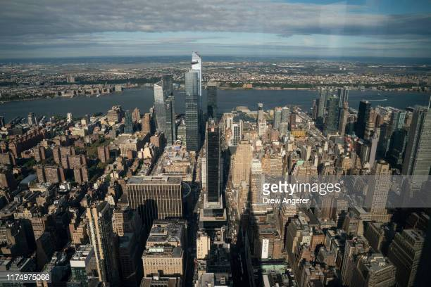 View of the West Side of Manhattan and Hudson Yards development from inside the newly renovated 102nd floor observatory of the Empire State Building...