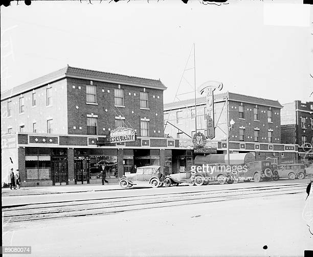 View of the Western Hotel in Cicero Illinois viewed at an angle from across the street 1929 Automobiles are parked in front of the hotel and a...