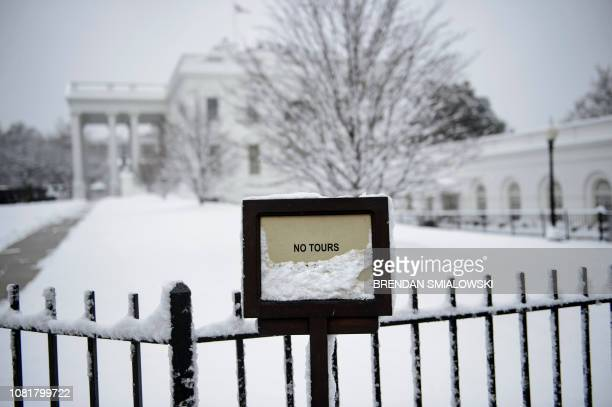 A view of the White House during a winter storm on the 23rd day of the US government shutdown January 13 2019 in Washington DC Washington area...