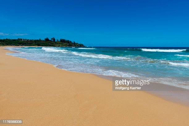 View of the white sand beach at Kealia Beach Park near Kaapa on the eastern side of the Hawaiian Island of Kauai Hawaii USA