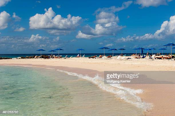 View of the white sand beach with tourists at the Hilton Barbados on Barbados an island in the Caribbean