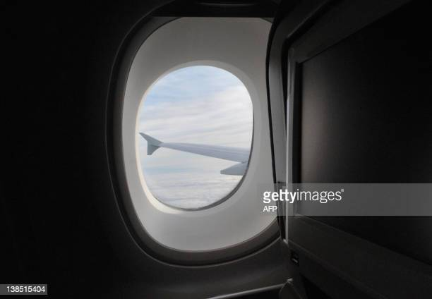 View of the wing of the Air France Airbus A380 taken during its flight from the Airbus plant in Hamburg Germany to Paris' Roissy Airport on October...