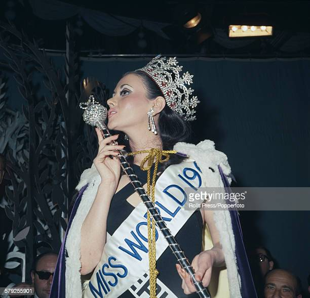 View of the winner of the 1967 Miss World beauty pageant Madeline HartogBel of Peru wearing her crown and staff at the Lyceum Ballroom in London on...