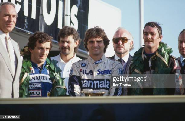 View of the winners of the 1983 European Grand Prix posed together on the podium with from left 2nd placed Alain Prost of France first placed winner...