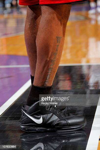 A view of the 'Witness' tattoo on the leg of LeBron James of the Miami Heat during the game against the Sacramento Kings on December 11 2010 at ARCO...