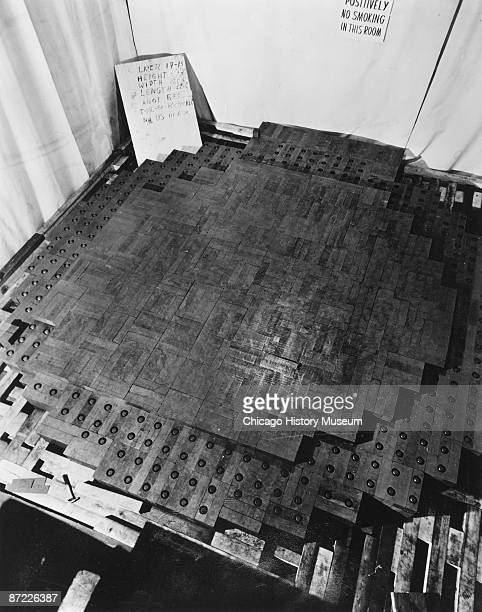 View of the world's first nuclear pile taken during its construction shows dozens of uranium pellets embedded in graphite blocks Chicago November...