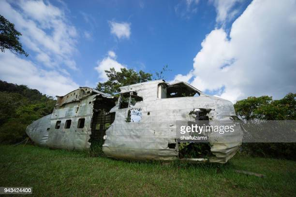 view of the wreck of a scottish aviation twin pioneer aircraft at bario, sarawak - a well known place as one of the major organic rice supplier in malaysia. - shaifulzamri stock-fotos und bilder