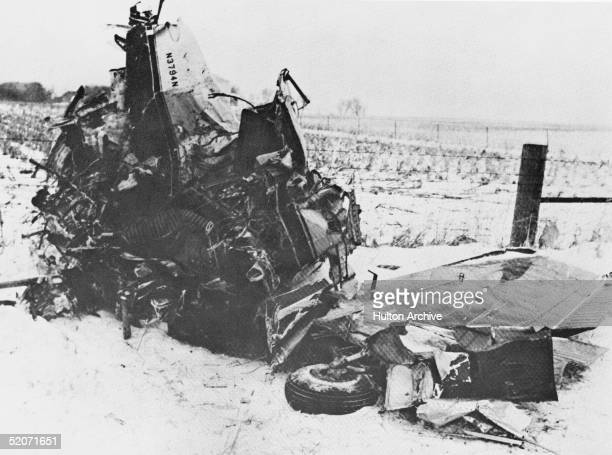 View of the wreckage of a Beechcraft Bonanza airplane in a snowy field outside of Clear Lake Iowa early February 1959 The crash on February 3 claimed...