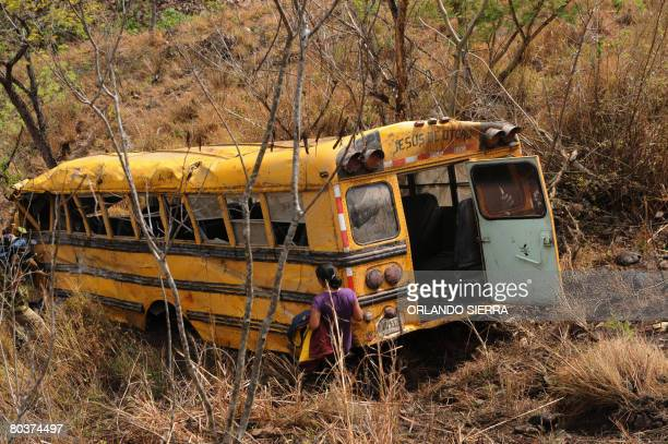 View of the wreckage of a bus which run off the road 500 m downhill in the route linking San Isidro with Jesus de Otero department of La Esperanza...