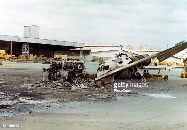 View of the wreckage of a North American F100 Super Sabre jet fighter from the 3rd Tactical Fighter Wing destroyed when a Viet Cong mortar attack hit...
