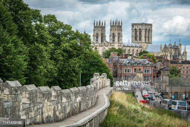 View of the York Minster towering over the historic city of York from the city walls, Yorkshire, United Kingdom.