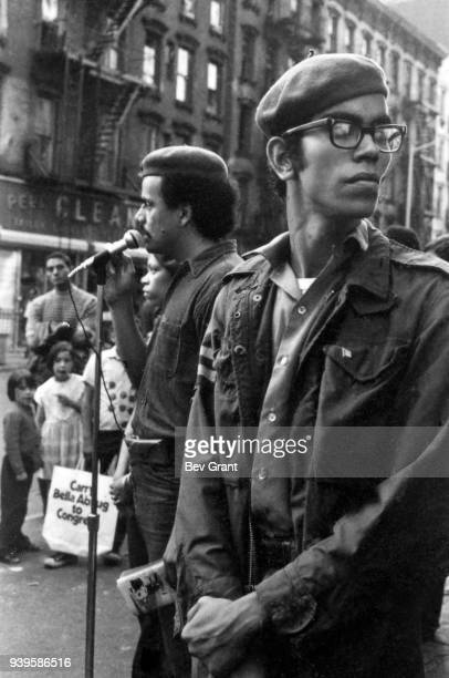 View of the Young Lords Party's Minister of Health Carlito Rovira as the group's Minister of Education Carlos Aponte speaks to people on an East...