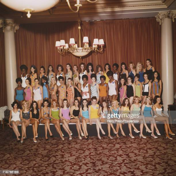 View of thirty two of the contestants who will line up to compete in the 1968 Miss World beauty pageant posed together in swimsuits for a photocall...