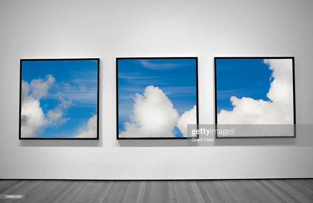 View of three framed photographs. : Foto de stock
