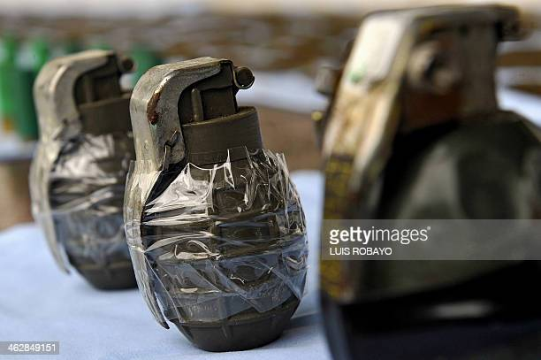 View of three hand grenades seized with 12000 rifle cartridges of different calibers and antiaircraft ammunitions as they are shown to the press on...