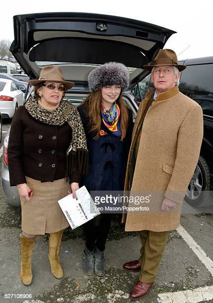 View of three racing fans standing beside a car during the 2012 Cheltenham National Hunt Festival at Cheltenham racecourse in Gloucestershire on 15th...