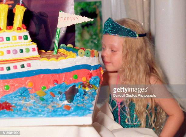 View of Tiffany Trump as she looks at 'Titanic'themed cake during her fifth birthday party at the MaraLago estate Palm Beach Florida October 13 1998