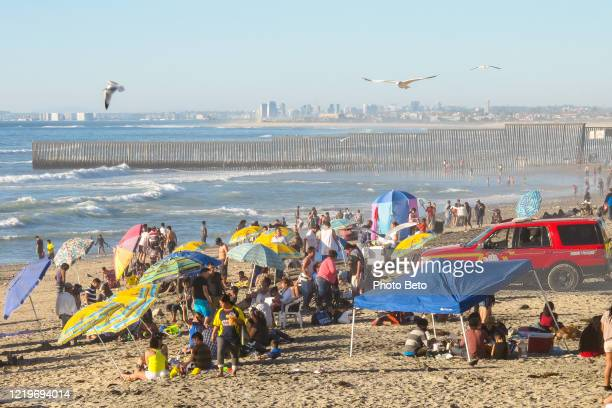 a view of tijuana beach and the wall border between united states and mexico - between stock pictures, royalty-free photos & images