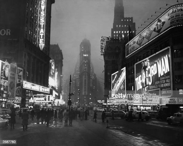 A view of Times Square at night New York City New York circa 1949