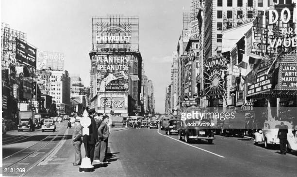 A view of Times Square at the intersection of Broadway and 7th Avenue New York City New York 1937