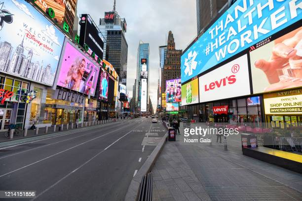 View of Times Square hours ahead of the implementation of 'New York State on PAUSE' executive order as the coronavirus continues to spread across the...