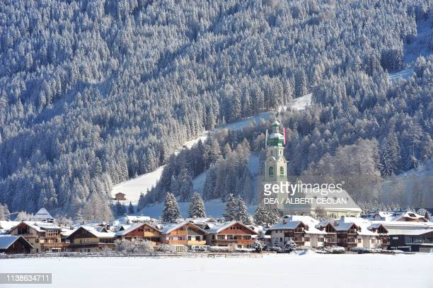 View of Toblach under the snow with St John the Baptist church on the right Puster valley TrentinoAlto Adige Italy