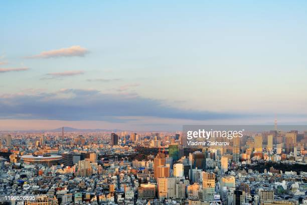 view of tokyo cityscape at sunset - olympic stadium stock pictures, royalty-free photos & images