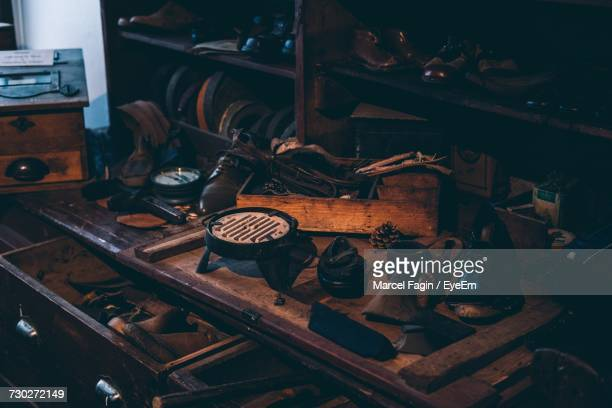 view of tools in workshop - shoemaker stock photos and pictures