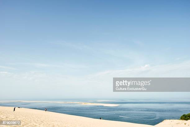 View of tourists on Dune du Pilat and sea, Aquitaine, France