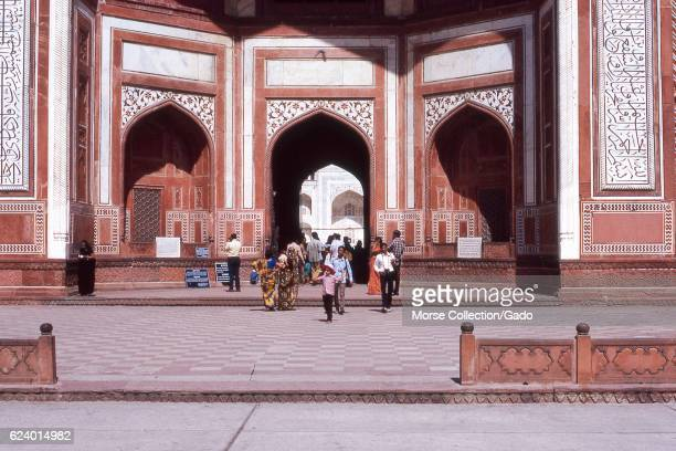 View of tourists walking outside the entrance to the Jama Masjid Mosque, in the city of Fatehpur Sikri, in the Agra district of Uttar Pradesh, India,...