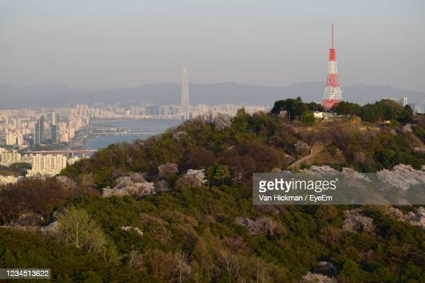 view of tower and buildings in city - south korea stock pictures, royalty-free photos & images