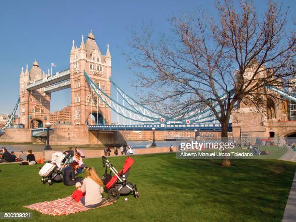 CONTENT] A view of Tower Bridge at sunset with a few people and families This is a place used for locals and tourists everyday because it is one of...