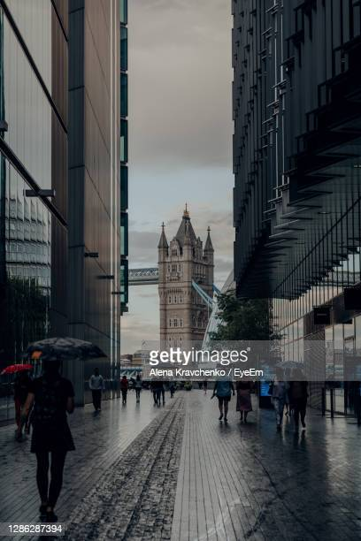 view of tower bridge from more london, a part of london bridge city, uk. - dark stock pictures, royalty-free photos & images