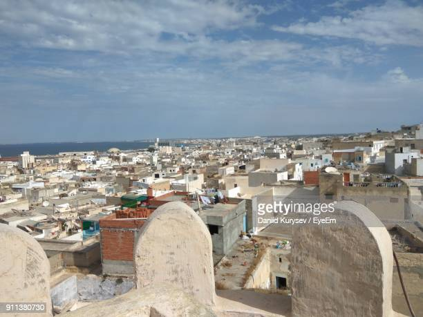 view of town against cloudy sky - sousse stock pictures, royalty-free photos & images