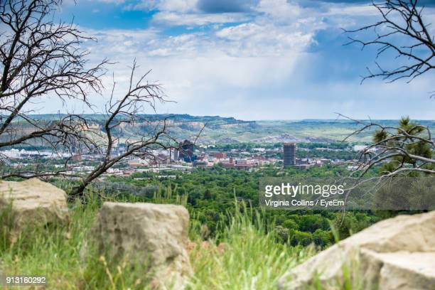 view of town against cloudy sky - billings montana stock pictures, royalty-free photos & images