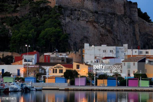 view of town at seaside - denia stock pictures, royalty-free photos & images