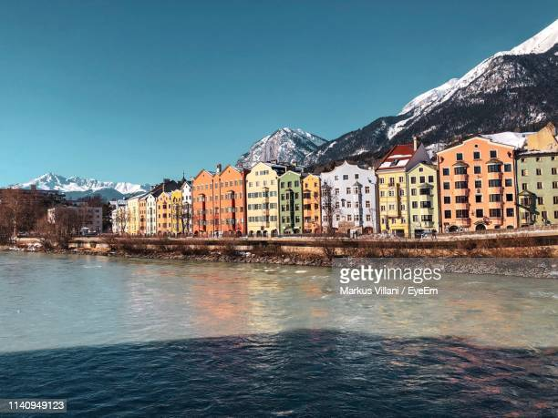 view of town by sea against sky - innsbruck stock pictures, royalty-free photos & images