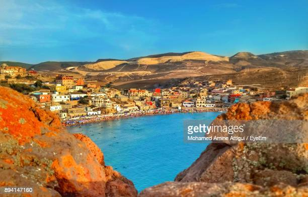 view of town by sea - algeria stock pictures, royalty-free photos & images