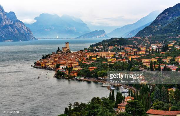 view of town by sea - malcesine stock pictures, royalty-free photos & images