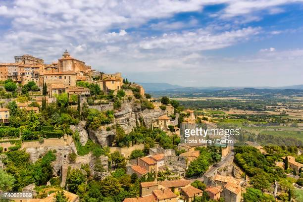 view of townscape against cloudy sky - provence alpes cote d'azur stock photos and pictures