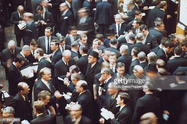 View of traders and workers dealing on the floor of the London Stock Exchange Capel Court building in the City of London following the shock...