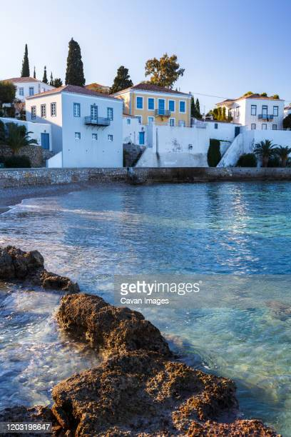 view of traditional architecture in spetses village, greece. - spetses stock pictures, royalty-free photos & images