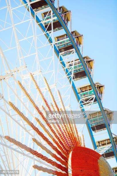 View of traditional ferris wheel against clear sky from underneath. Oktoberfest, Munich, Bavaria, Germany.