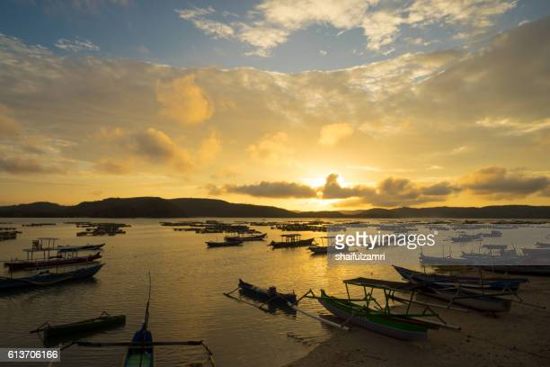 view of traditional fisherman village during majestic sunrise - shaifulzamri stock-fotos und bilder