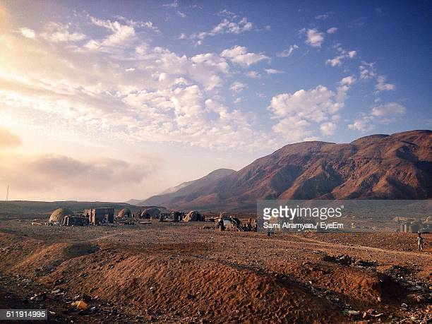 view of traditional houses against mountains - djibouti stock pictures, royalty-free photos & images