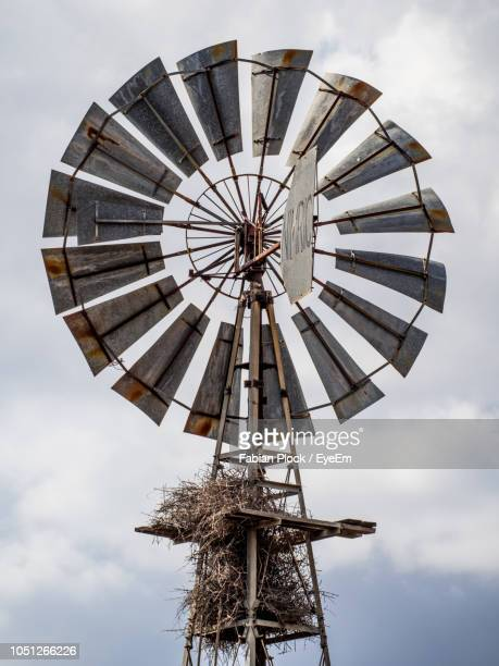 view of traditional windmill against sky, kruger national park, south africa - traditional windmill stock photos and pictures