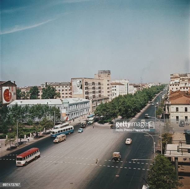 View of traffic moving up and down a tree lined boulevard in the Soviet Russian city of Novosibirsk in Siberia Asia circa 1970