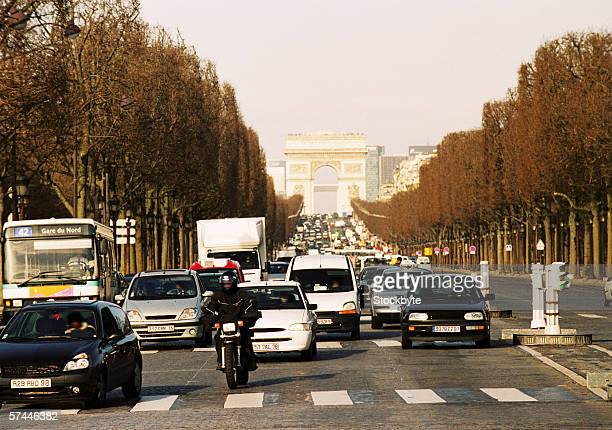 view of traffic on the street of the arc de triomphe in Paris