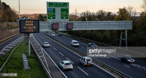 """View of traffic traveling on the A470 with gantry signs reminding travelers to """"Stay Home To Save Lives"""" on November 05, 2020 in Cardiff, Wales. In..."""