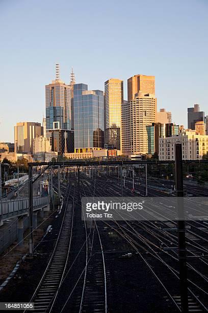 View of train tracks and city buildings, Melbourne, Victoria, Australia